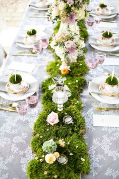 soft lace and luscious moss add a lovely vintage and upscale rustic feeling to a beautiful table setting.