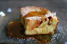 Boozy Baked French Toast - Sliced Challah bread or any bread you like, 3 C milk, 3 eggs, 1tbs sugar, dash of salt, 1 tsp vanilla, 3 tbs Bailey's Irish Creme. Butter pan, layer bread, pour in mixture and bake @425 for 30 minute.  Serve however you like it w/syrup, powdered sugar, fruit etc.