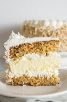 With two layers of carrot cake sandwiching one layer of cheesecake, this carrot cake cheesecake cake is the only dessert you'll need this Easter!