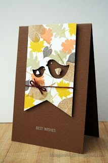 handmade card from little things: Autumn mood ... deep chocolate card base ... transluscent solid leaves overlapping in Fall colors ... wide fishtail banner ... negative die cut birds with heart wings ... clean and simple design ... great card!!