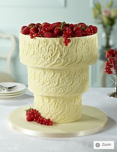 Beautiful white chocolate up-side-down cake... HELP, a friend has asked that I make this for her wedding... ANY tips and tricks on making/handling/attaching the solid textured white chocolate collars????