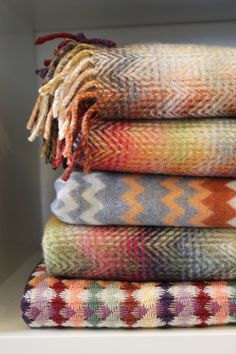 Missoni Home Throws in autumnal colours. Available at shop.tessuti.co.nz.