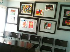 recycled old frames painted and used as a 'gallery wall' for kid's art projects