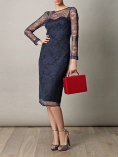 Lace shift dress paired with a pop of red