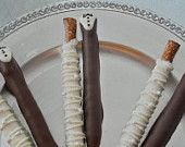 Edible Wedding Favors Chocolate Dipped Bride and Groom Pretzel Rods Frost the Cake. $36.00, via Etsy.