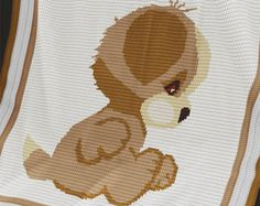 """Crochet Baby Blanket / Afghan pattern.  THIS PATTERN IS IN ENGLISH ONLY. ----------------------------------------------------------------------  FULL ROW-BY-ROW described version of this pattern can be purchased at www.PatternWorld.co.uk ----------------------------------------------------------------------  Materials: Cygnet DK - 100% Acrylic - 298m / 100g (326 yds); 4.00 mm crochet hook  Finished size: 25.5"""" (64 cm) x 29.5""""(74 cm).  Gauge: 18 dc(UK) or 18 sc(USA) and 22 rows &#x3D..."""