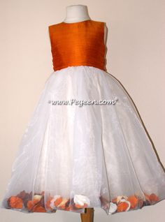 Flower girl dress in pumpkin orange and ivory with flower petals in the skirt in over 200 colors of silk from infants through plus sizes.