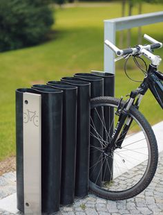 MEANDRE. Red Dot Design Award 2010. This double-sided stand with an entirely new unique design in a distinct and naturally elegant shape is unprecedentedly bike-friendly. Its characteristic meander made from a durable rubber-strip can softly but firmly clasp the front or back wheel of any size.   | mmcité street furniture |