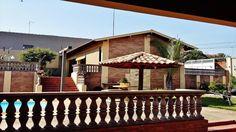Izildo Aroa imóveis, Vende em Matão, Excelente casa estilo colonial rustico, toda construida com tijolos aparentes, com  piscina, grande área de lazer, 2 entradas.