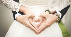 Midsection of Woman Making Heart Shape With Hands · Free Stock Photo