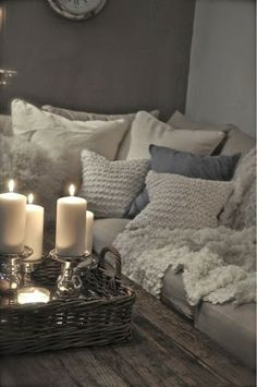 Such a great place to relax...like the basket with the glass candle holders, and textures on the pillows.  <3