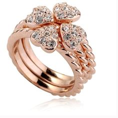 Interlocking Hearts Ring Rose gold interlocking heart rings.  Size 6.5 but fits like 6.25 when worn. Jewelry Rings