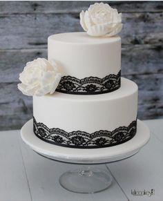 Simple 2 tier cake idea, lace added gives a vintage feel