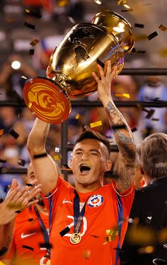 #COPA2016 #COPA100 Charles Aranguiz of Chile celebrates with the Copa America Centenario Trophy following the championship match between Argentina and Chile at MetLife...