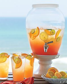 Seaside Sunrise: 2 cups pineapple juice 2 cups orange mango juice 2 cups passion fruit flavored rum 1 cup cranberry juice 2 tbsp. grenadine 1 bottle of sparkling wine Garnishes: orange and lime slices Combine first five ingredients in a large pitcher. Pour into ice filled glasses and top with sparkling wine. Makes 11 cups.