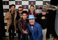 "(L-R) Graham ""Suggs"" McPherson, Daniel ""Woody"" Woodgate, Chris ""Chrissy Boy"" Foreman and Lee ""Kix"" Thompson of Madness pose with Harley Alexander-Sule (1st L) and Jordan Stephens (3rd L) of Rizzle Kicks"