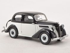 Neo Ford Eifel Resin Model Car 44547 This Ford Eifel Resin Model Car is Black and White and features comes in a display case. It is made by Neo and is scale (approx. Corgi Toys, Diecast Model Cars, Ford Models, Honda Civic, Display Case, Scale Models, Hot Wheels, Vip, Classic Cars