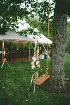 Tree swing decorated with flowers