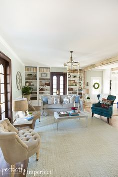Sweet House Alabama | Perfectly Imperfect | The Herndon House Billy bookcases from Ikea to create built ins along the back wall in the living room to give them loads of storage