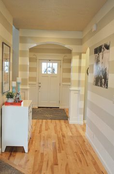 beautifully bold, striped walls in the entry way.  entryway.  home decor and interior decorating ideas.  paint.