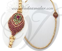 Ruby and emerald studded side pendant, traditionally called the Kodi Moppu. Gold plated South Indian ornament