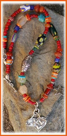 Trade Bead Necklace... Venetian and African Trade beads adorned with ancient crystal quartz and carnelian (over 2000 years old). Mixed with a few modern gems-- Turquoise, Orange Spiney and Apatite. Artisan handcrafted sterling silver. Necklace measures 18.0 inches