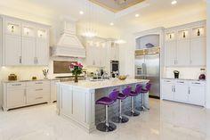 With a little pop of colour, Reunion Resort 7500's modern kitchen boasts luxury. #kitcheninspiration