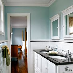 Narrow small bathroom after remodel with his-and-hers sinks, watery-blue walls to add a serene feel to the space. Valspar's Blue Arrow.