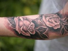Rose tattoo design on sleeve