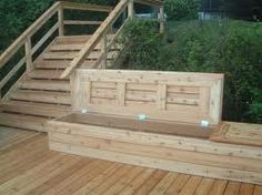 a bench with lid, but with siding on the sides to match the house