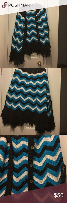 "KNITTED CAPE/PONCHO Wrap yourself in the warm,cozy bliss and timeless cape. Multi colored chevron patten throughout in brown, white & turquoise color and fringe hem. Open neckline and front buttons. Length 33"". Made by my great auntie Jackets & Coats Capes"