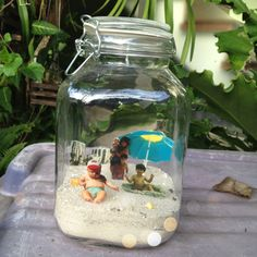 Beach memory jar. Maybe try with a shadow box?