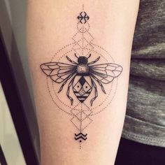 Dotted Black Bee Tattoo. The tribal bee serves the important role in our life. They provide us with the food and larvae and provides defense. So consider this tattoo for the inspiratio0n.