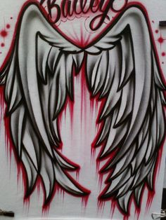 Airbrushed wings on the back of a t-shirt.  ------------------------------------------- The Trouble With Ink Custom airbrushing, printing, t-shirts, hats, canvas, anything you bring us. 4200 S Freeway #1043 817-305-1456 in La Gran Plaza (old Town Center Mall)