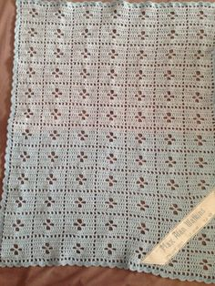 Crochet blanket personalised with cross stitch