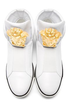 White Leather Medusa High-Top Sneakers by Versace. Round toe. Elasticized gore panel at front vamp. Raised signature Medusa head in gold-tone metal at overlong padded tongue. Padded heel collar. Black welt. White rubber sole and black foxing stripe with signature Greek key pattern throughout. http://zocko.it/LEW7o