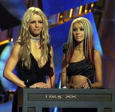 Britney Spears and Christina Aguilera onstage to present an award at the 2000 MTV Music Video Awards in New York on September 7, 2000.