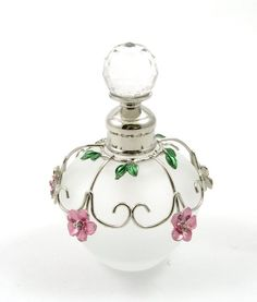 Round frosted perfume bottle with flower decoration
