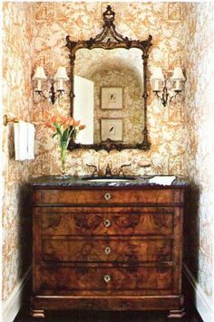 Petite powder room with toile walls, sconces, antique mirror and dresser converted into a sink basin - Southern Accents