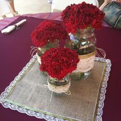 My mom made the burlap placemats with lace & green ribbon. We made the mason jars & did flower arrangements