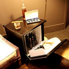 Man table mini refrigerator end table. Does this come in black?!