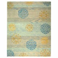 Hand-tufted wool rug with a medallion motif.  Product: RugConstruction Material: WoolColor: Blue and multiFeatures: Hand-tufted Note: Please be aware that actual colors may vary from those shown on your screen. Accent rugs may also not show the entire pattern that the corresponding area rugs have.