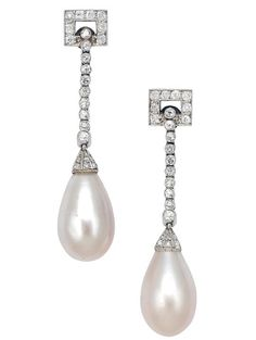 An Art Deco Pair of Natural Pearl and Diamond Ear Pendants, Chaumet, circa 1920  Suspending a pair of natural pearl drops measuring approximately 14.5 mm by 9.0 mm, from geometric surmounts and flexible lines and caps accented by round and rose-cut diamonds, mounted in platinum, maker's mark for Joseph Chaumet, with original box
