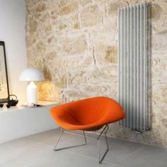 Bertoia Diamond chair, Atollo Lamp and lovely exposed stone wall.