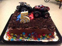 """This is the easy way i.e. """"lazy"""" way to make a monster truck themed birthday cake. My 4th son is a monster truck FANactic! Well unfortunately for him and me, his bday always seems to come around the worst of the pollen season and the height of my asthma flare ups. I was just not feeling up to to snuff enough to bake and decorate the whole cake thing, so I came up with this easy solution."""