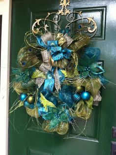 Turquoise & Green Peacock Christmas Wreath by Greatwood Floral Designs.