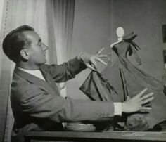 Jacques Griffe 1909 - 1996 France. Couturier. Opened his own couture house in 1942. Known for his cutting and draping and his clothes were fluid and soft.