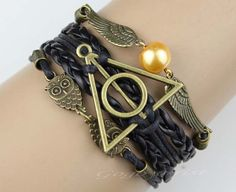 obsessed with this geek fashion website. harry potter themed leather bracelet with the deathly hallows, hedwig, and golden snitch Hogwarts, Harry Potter Accesorios, Harry Potter Bracelet, Geek Fashion, Harry Potter Love, Maquillage Halloween, Cool Stuff, Stuff To Buy, Just In Case