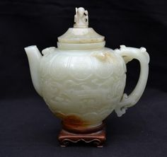 This antique carved Chinese Jade teapot with cover and spherical shaped body, beautifully carved and ornamented with numerous Chinese dragons and other motifs recently sold on Ebay at auction for thirty grand.