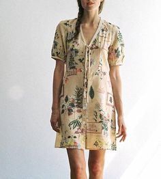 This printed, floral dress, with its buttons, bow and slight puffed sleeves, is an easy, laid back charmer.